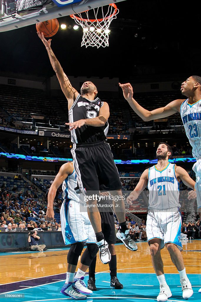 Tony Parker #9 of the San Antonio Spurs shoots a layup against Anthony Davis #23 of the New Orleans Hornets on January 7, 2013 at the New Orleans Arena in New Orleans, Louisiana.