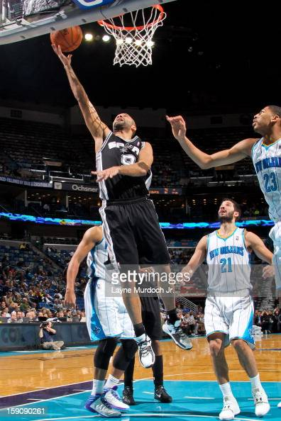 Tony Parker of the San Antonio Spurs shoots a layup against Anthony Davis of the New Orleans Hornets on January 7 2013 at the New Orleans Arena in...