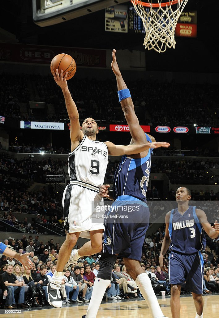 Tony Parker #9 of the San Antonio Spurs shoots a layup against Erick Dampier #25 of the Dallas Mavericks on January 8, 2010 at the AT&T Center in San Antonio, Texas.