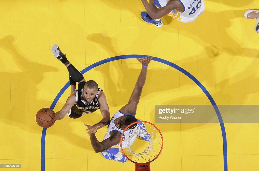 Tony Parker #9 of the San Antonio Spurs shoots a layup against <a gi-track='captionPersonalityLinkClicked' href=/galleries/search?phrase=Festus+Ezeli&family=editorial&specificpeople=5725219 ng-click='$event.stopPropagation()'>Festus Ezeli</a> #31 of the Golden State Warriors in Game Four of the Western Conference Semifinals during the 2013 NBA Playoffs on May 12, 2013 at Oracle Arena in Oakland, California.