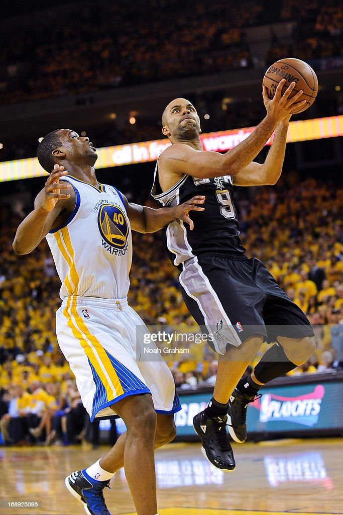 Tony Parker #9 of the San Antonio Spurs shoots a layup against Harrison Barnes #40 of the Golden State Warriors in Game Six of the Western Conference Semifinals during the 2013 NBA Playoffs on May 16, 2013 at Oracle Arena in Oakland, California.