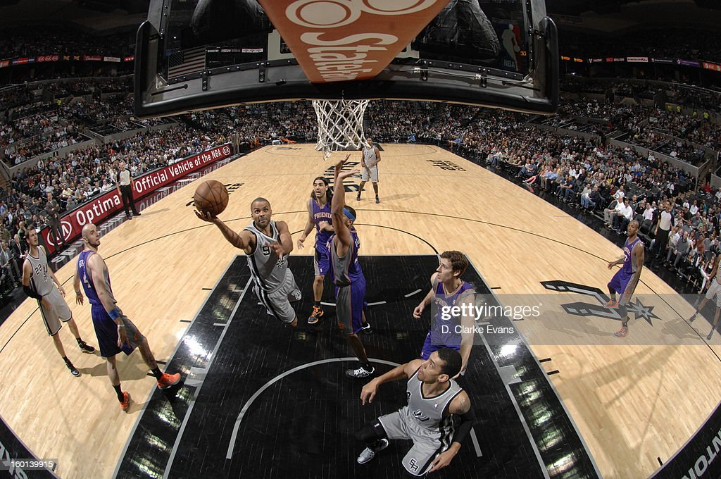 Tony Parker #9 of the San Antonio Spurs shoots a layup against <a gi-track='captionPersonalityLinkClicked' href=/galleries/search?phrase=Jared+Dudley&family=editorial&specificpeople=224071 ng-click='$event.stopPropagation()'>Jared Dudley</a> #3 of the Phoenix Suns on January 26, 2013 at the AT&T Center in San Antonio, Texas.