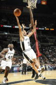 Tony Parker of the San Antonio Spurs shoots a layup against Joel Anthony of the Miami Heat on December 31 2009 at the ATT Center in San Antonio Texas...