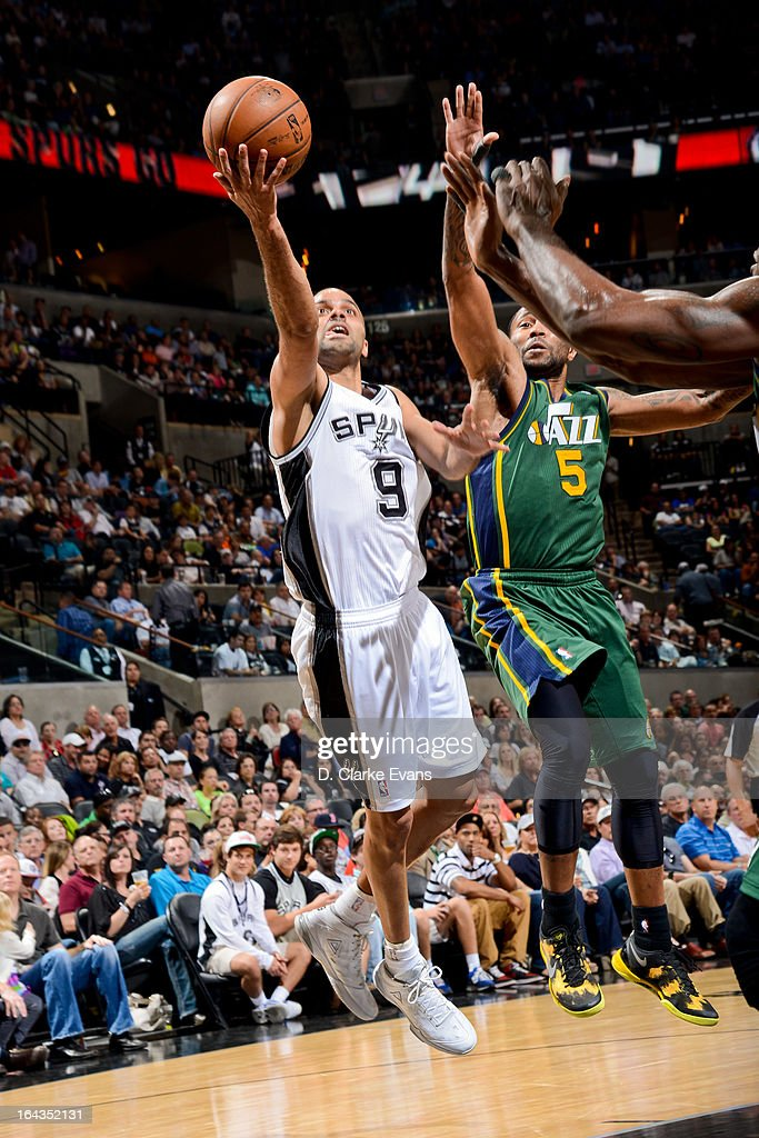 Tony Parker #9 of the San Antonio Spurs shoots a layup against Mo Williams #5 of the Utah Jazz on March 22, 2013 at the AT&T Center in San Antonio, Texas.