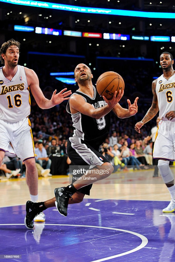 <a gi-track='captionPersonalityLinkClicked' href=/galleries/search?phrase=Tony+Parker&family=editorial&specificpeople=160952 ng-click='$event.stopPropagation()'>Tony Parker</a> #9 of the San Antonio Spurs shoots a layup against <a gi-track='captionPersonalityLinkClicked' href=/galleries/search?phrase=Pau+Gasol&family=editorial&specificpeople=201587 ng-click='$event.stopPropagation()'>Pau Gasol</a> #16 of the Los Angeles Lakers in Game Four of the Western Conference Quarterfinals during the 2013 NBA Playoffs at Staples Center on April 28, 2013 in Los Angeles, California.