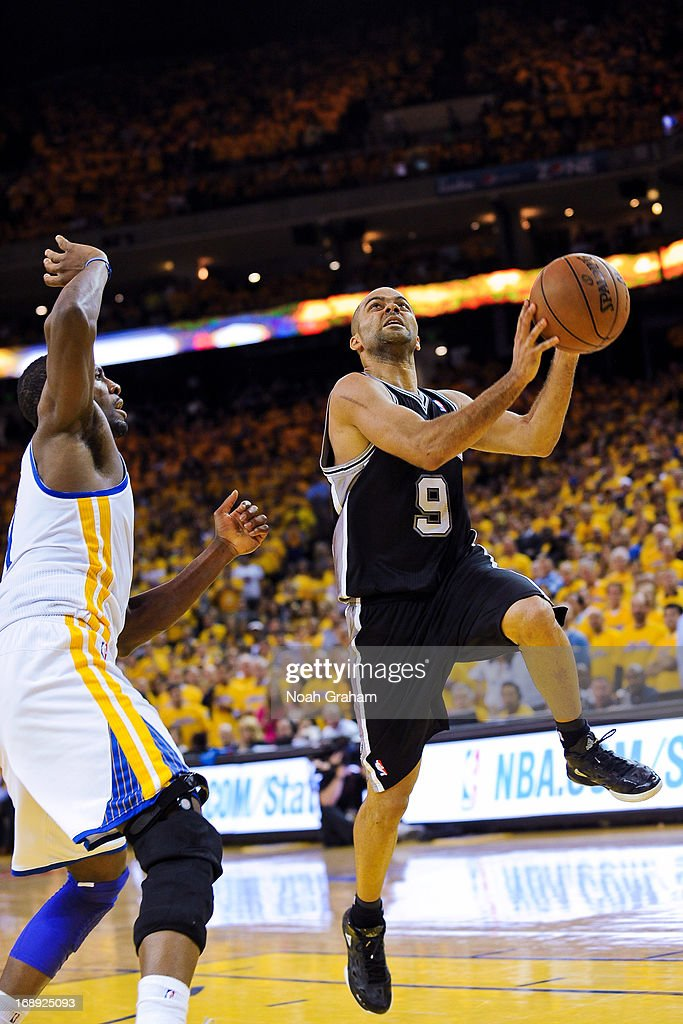 Tony Parker #9 of the San Antonio Spurs shoots a layup against the Golden State Warriors in Game Six of the Western Conference Semifinals during the 2013 NBA Playoffs on May 16, 2013 at Oracle Arena in Oakland, California.