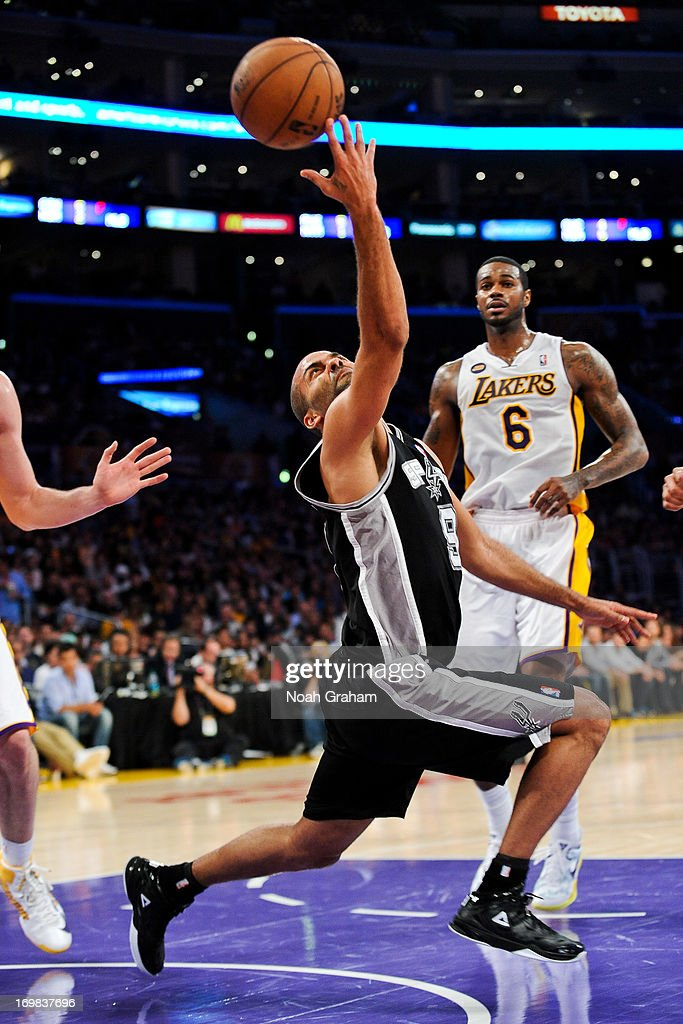 <a gi-track='captionPersonalityLinkClicked' href=/galleries/search?phrase=Tony+Parker&family=editorial&specificpeople=160952 ng-click='$event.stopPropagation()'>Tony Parker</a> #9 of the San Antonio Spurs shoots a layup against the Los Angeles Lakers in Game Four of the Western Conference Quarterfinals during the 2013 NBA Playoffs at Staples Center on April 28, 2013 in Los Angeles, California.