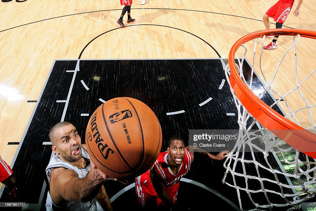 <a gi-track='captionPersonalityLinkClicked' href=/galleries/search?phrase=Tony+Parker&family=editorial&specificpeople=160952 ng-click='$event.stopPropagation()'>Tony Parker</a> #9 of the San Antonio Spurs shoots a layup against the Houston Rockets on December 28, 2012 at the AT&T Center in San Antonio, Texas.