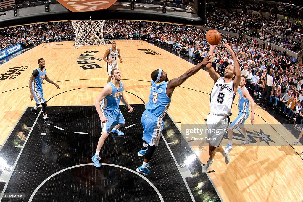 Tony Parker #9 of the San Antonio Spurs shoots a layup against <a gi-track='captionPersonalityLinkClicked' href=/galleries/search?phrase=Ty+Lawson&family=editorial&specificpeople=4024882 ng-click='$event.stopPropagation()'>Ty Lawson</a> #3 of the Denver Nuggets on March 27, 2013 at the AT&T Center in San Antonio, Texas.