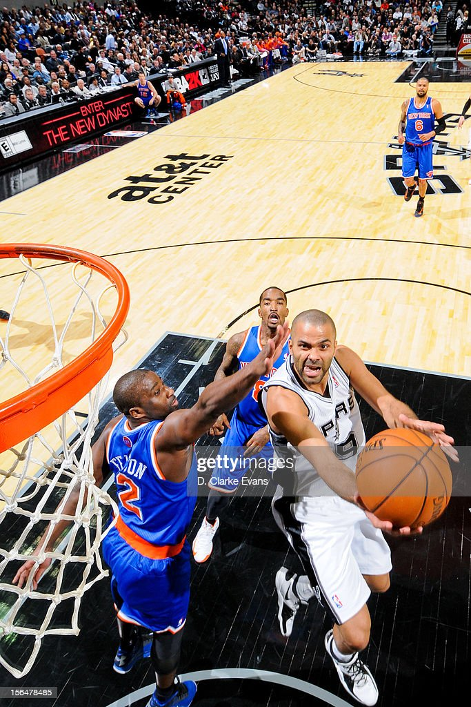 Tony Parker #9 of the San Antonio Spurs shoots a reverse layup against <a gi-track='captionPersonalityLinkClicked' href=/galleries/search?phrase=Raymond+Felton&family=editorial&specificpeople=209141 ng-click='$event.stopPropagation()'>Raymond Felton</a> #2 of the New York Knicks on November 15, 2012 at the AT&T Center in San Antonio, Texas.