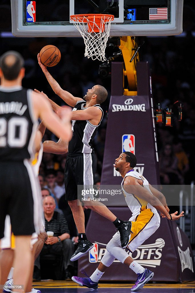 <a gi-track='captionPersonalityLinkClicked' href=/galleries/search?phrase=Tony+Parker&family=editorial&specificpeople=160952 ng-click='$event.stopPropagation()'>Tony Parker</a> #9 of the San Antonio Spurs shoots a reverse layup against the Los Angeles Lakers in Game Four of the Western Conference Quarterfinals during the 2013 NBA Playoffs at Staples Center on April 28, 2013 in Los Angeles, California.