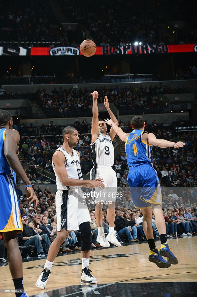 Tony Parker #9 of the San Antonio Spurs shoots a three point shot in a game against <a gi-track='captionPersonalityLinkClicked' href=/galleries/search?phrase=Klay+Thompson&family=editorial&specificpeople=5132325 ng-click='$event.stopPropagation()'>Klay Thompson</a> #11 of the Golden State Warriors on January 18, 2013 at the AT&T Center in San Antonio, Texas.