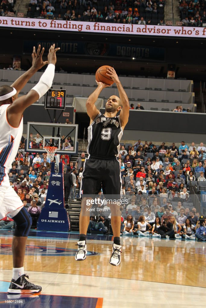 Tony Parker #9 of the San Antonio Spurs shoots against Brendan Haywood #33 of the Charlotte Bobcats at the Time Warner Cable Arena on December 8, 2012 in Charlotte, North Carolina.