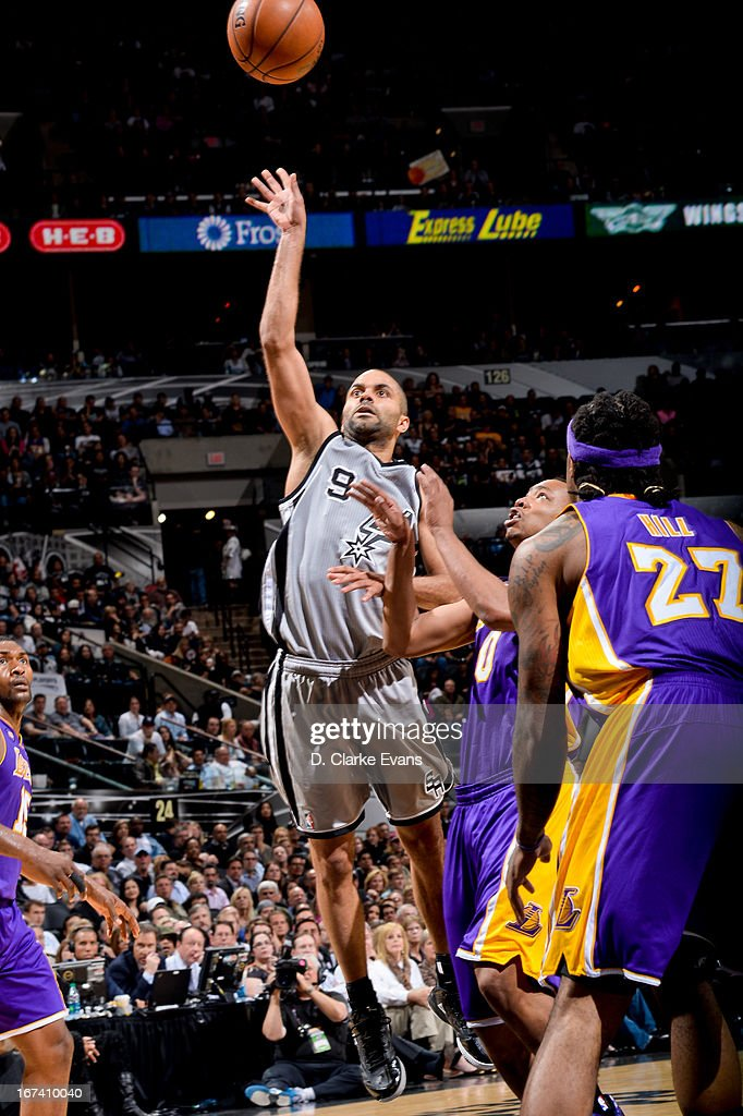 Tony Parker #9 of the San Antonio Spurs shoots against Dwight Howard #12 of the Los Angeles Lakers in Game Two of the Western Conference Quarterfinals during the 2013 NBA Playoffs on April 24, 2013 at the AT&T Center in San Antonio, Texas.