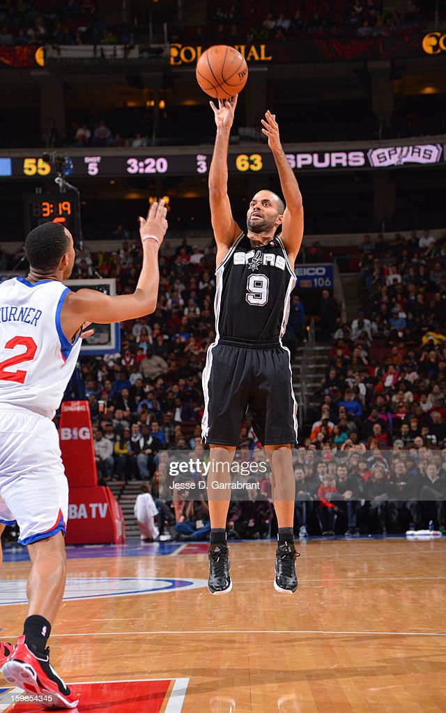 Tony Parker #9 of the San Antonio Spurs shoots against <a gi-track='captionPersonalityLinkClicked' href=/galleries/search?phrase=Evan+Turner&family=editorial&specificpeople=4665764 ng-click='$event.stopPropagation()'>Evan Turner</a> #12 of the Philadelphia 76ers during the game at the Wells Fargo Center on January 21, 2013 in Philadelphia, Pennsylvania.