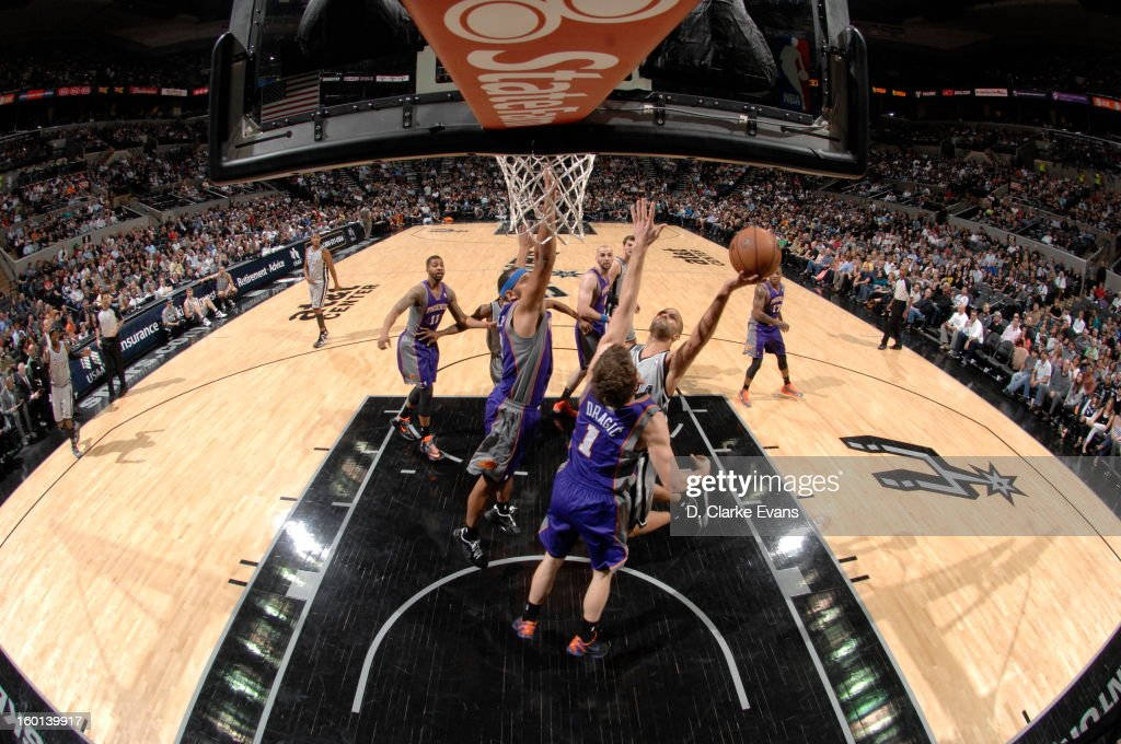 Tony Parker #9 of the San Antonio Spurs shoots against <a gi-track='captionPersonalityLinkClicked' href=/galleries/search?phrase=Goran+Dragic&family=editorial&specificpeople=4452965 ng-click='$event.stopPropagation()'>Goran Dragic</a> #1 of the Phoenix Suns on January 26, 2013 at the AT&T Center in San Antonio, Texas.