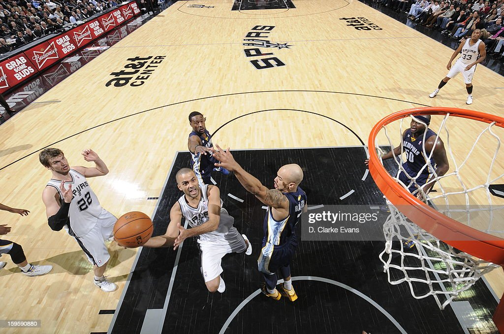 Tony Parker #9 of the San Antonio Spurs shoots against Jerryd Bayless #7 of the Memphis Grizzlies on January 16, 2013 at the AT&T Center in San Antonio, Texas.
