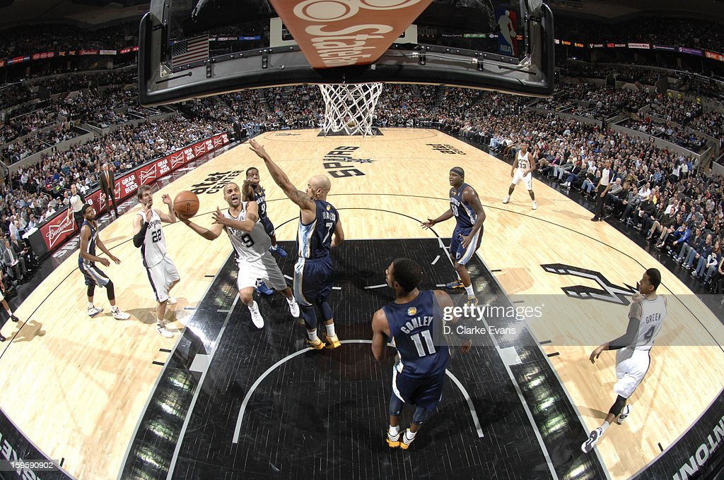 Tony Parker #9 of the San Antonio Spurs shoots against <a gi-track='captionPersonalityLinkClicked' href=/galleries/search?phrase=Jerryd+Bayless&family=editorial&specificpeople=4216027 ng-click='$event.stopPropagation()'>Jerryd Bayless</a> #7 of the Memphis Grizzlies on January 16, 2013 at the AT&T Center in San Antonio, Texas.