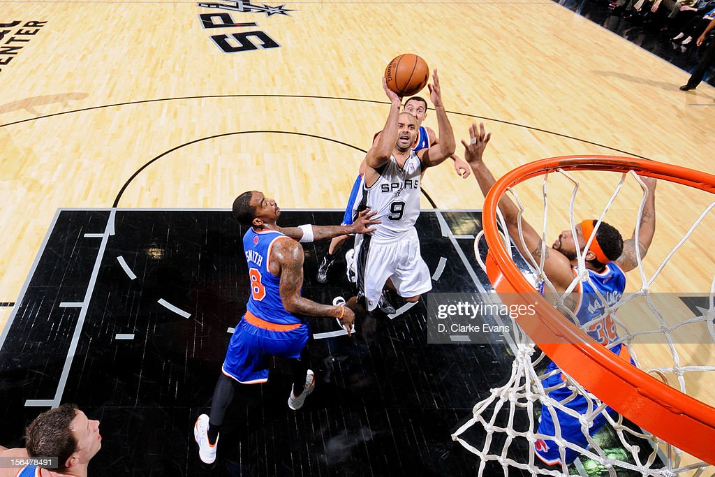 Tony Parker #9 of the San Antonio Spurs shoots against <a gi-track='captionPersonalityLinkClicked' href=/galleries/search?phrase=J.R.+Smith&family=editorial&specificpeople=201766 ng-click='$event.stopPropagation()'>J.R. Smith</a> #8 and <a gi-track='captionPersonalityLinkClicked' href=/galleries/search?phrase=Rasheed+Wallace&family=editorial&specificpeople=201483 ng-click='$event.stopPropagation()'>Rasheed Wallace</a> #36 of the New York Knicks on November 15, 2012 at the AT&T Center in San Antonio, Texas.
