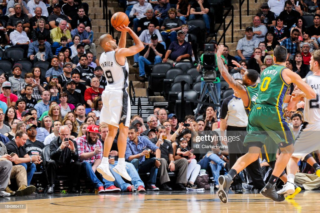 Tony Parker #9 of the San Antonio Spurs shoots against Mo Williams #5 of the Utah Jazz on March 22, 2013 at the AT&T Center in San Antonio, Texas.
