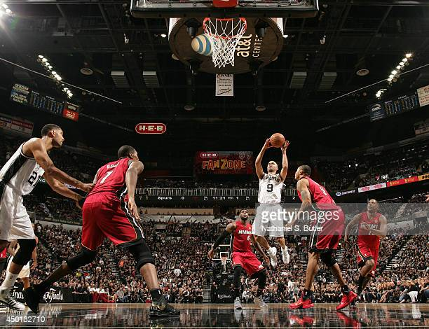 Tony Parker of the San Antonio Spurs shoots against Rashard Lewis of the Miami Heat in Game One of the 2014 NBA Finals at ATT Center on June 5 2014...