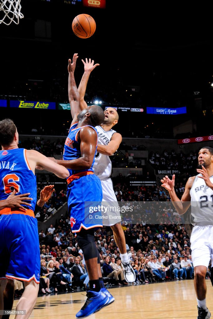 Tony Parker #9 of the San Antonio Spurs shoots against Raymond Felton #2 of the New York Knicks on November 15, 2012 at the AT&T Center in San Antonio, Texas.