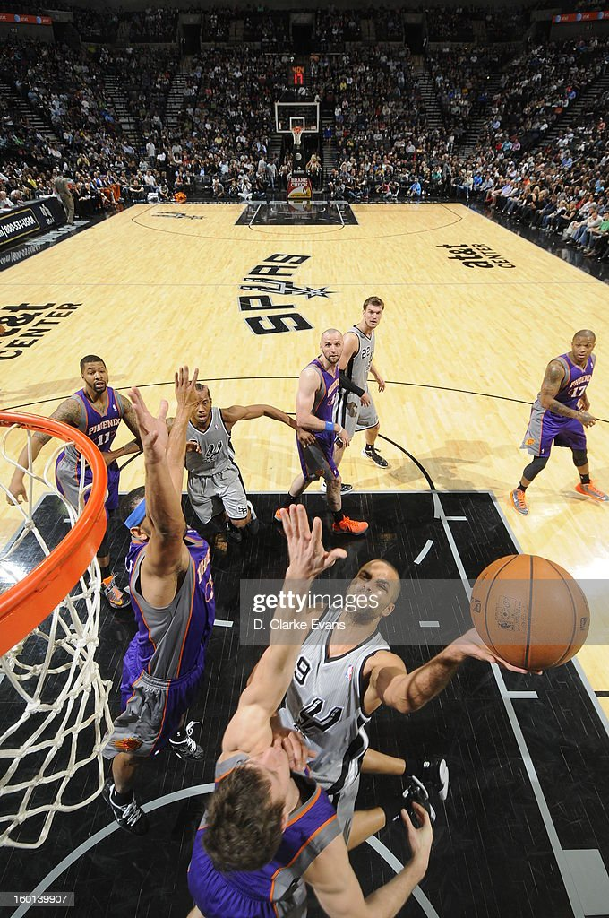 Tony Parker #9 of the San Antonio Spurs shoots against the Phoenix Suns on January 26, 2013 at the AT&T Center in San Antonio, Texas.