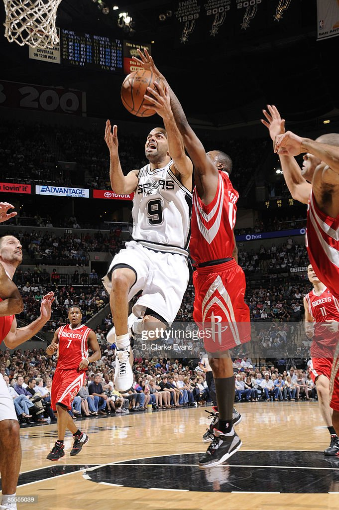 Tony Parker #9 of the San Antonio Spurs shoots against Von Wafer #13 of the Houston Rockets on March 22, 2009 at the AT&T Center in San Antonio, Texas.