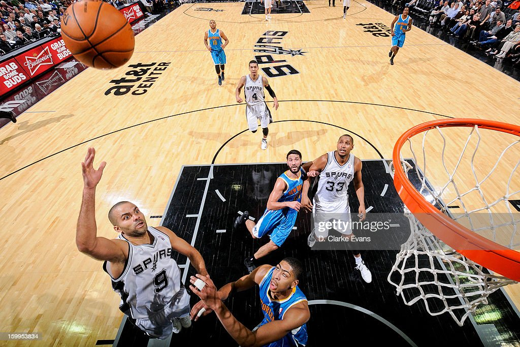 <a gi-track='captionPersonalityLinkClicked' href=/galleries/search?phrase=Tony+Parker&family=editorial&specificpeople=160952 ng-click='$event.stopPropagation()'>Tony Parker</a> #9 of the San Antonio Spurs shoots in the lane against Anthony Davis #23 of the New Orleans Hornets on January 23, 2013 at the AT&T Center in San Antonio, Texas.