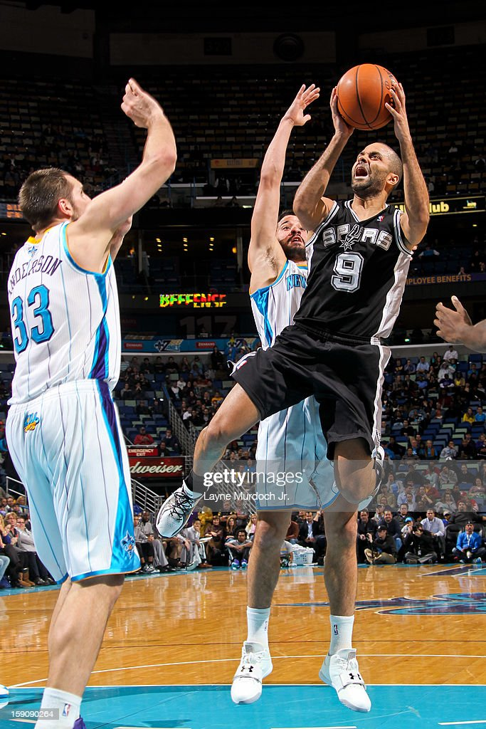 Tony Parker #9 of the San Antonio Spurs shoots in the lane against Ryan Anderson #33 and Greivis Vasquez #21 of the New Orleans Hornets on January 7, 2013 at the New Orleans Arena in New Orleans, Louisiana.