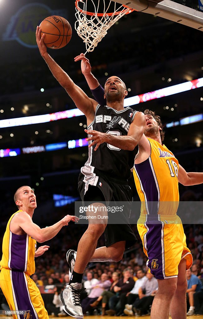 Tony Parker #9 of the San Antonio Spurs shoots over pau Gasol #16 of the Los Angeles Lakers at Staples Center on November 1, 2013 in Los Angeles, California.