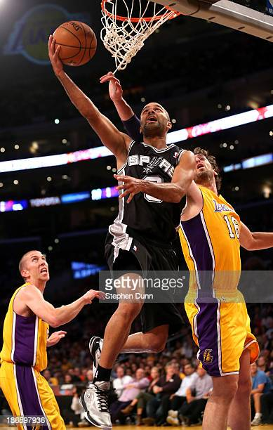 Tony Parker of the San Antonio Spurs shoots over pau Gasol of the Los Angeles Lakers at Staples Center on November 1 2013 in Los Angeles California...