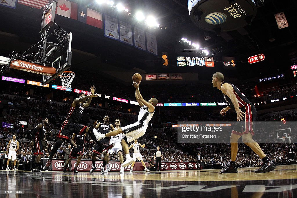 <a gi-track='captionPersonalityLinkClicked' href=/galleries/search?phrase=Tony+Parker&family=editorial&specificpeople=160952 ng-click='$event.stopPropagation()'>Tony Parker</a> #9 of the San Antonio Spurs shoots over <a gi-track='captionPersonalityLinkClicked' href=/galleries/search?phrase=Udonis+Haslem&family=editorial&specificpeople=201748 ng-click='$event.stopPropagation()'>Udonis Haslem</a> #40 of the Miami Heat in the first half during Game Four of the 2013 NBA Finals at the AT&T Center on June 13, 2013 in San Antonio, Texas.