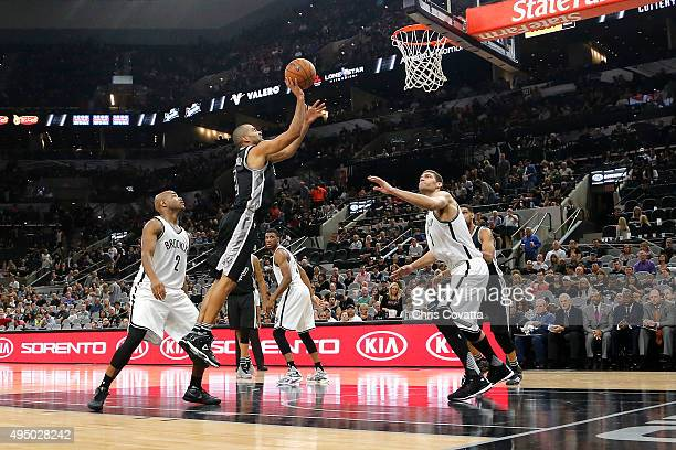Tony Parker of the San Antonio Spurs shoots the ball against the Brooklyn Nets at the ATT Center on October 30 2015 in San Antonio Texas NOTE TO USER...