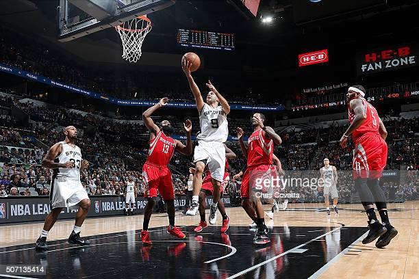 Tony Parker of the San Antonio Spurs shoots the ball against the Houston Rockets on January 27 2016 at the ATT Center in San Antonio Texas NOTE TO...