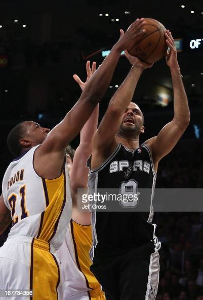 Tony Parker of the San Antonio Spurs shoots while defended by Chris Duhon of the Los Angeles Lakers in the first half during Game Four of the Western...