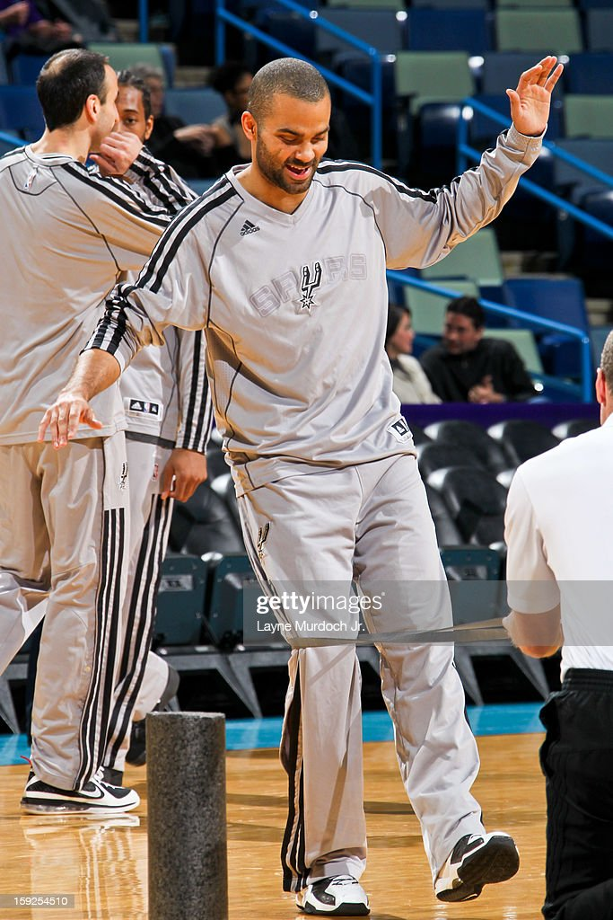 Tony Parker #9 of the San Antonio Spurs smiles while stretching before playing the New Orleans Hornets on January 7, 2013 at the New Orleans Arena in New Orleans, Louisiana.