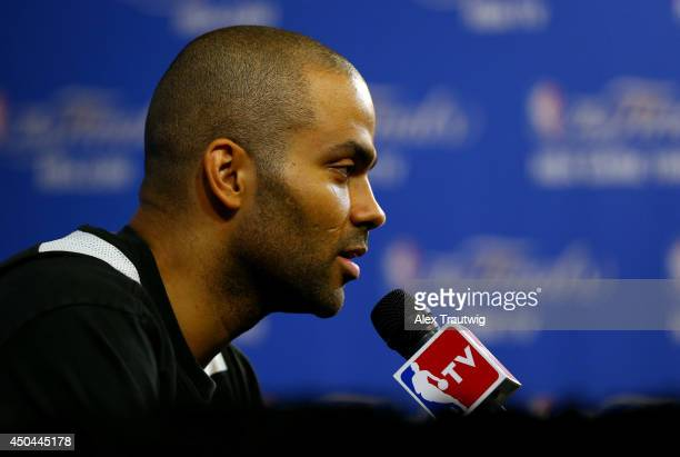 Tony Parker of the San Antonio Spurs speaks to the media after practice on an off day following Game Three of the 2014 NBA Finals against the Miami...
