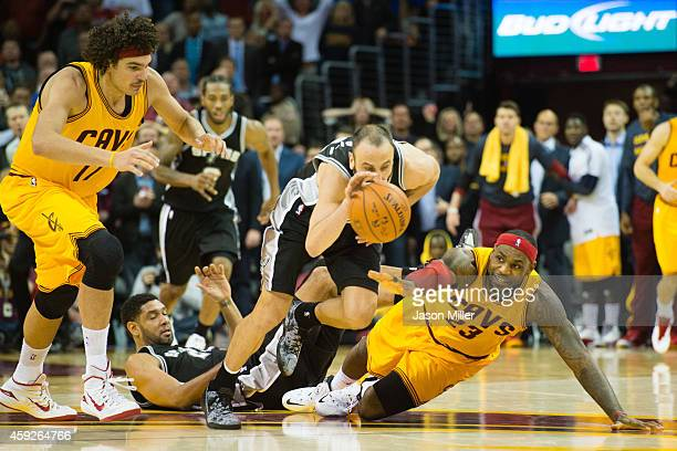 Tony Parker of the San Antonio Spurs steals the ball from LeBron James of the Cleveland Cavaliers during finals seconds of the second half at Quicken...