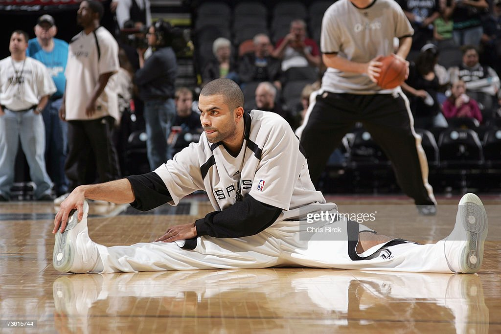 Tony Parker #9 of the San Antonio Spurs stretches before the NBA game against the Orlando Magic at AT&T Center on March 2, 2007 in San Antonio, Texas. The Spurs won 98-74.
