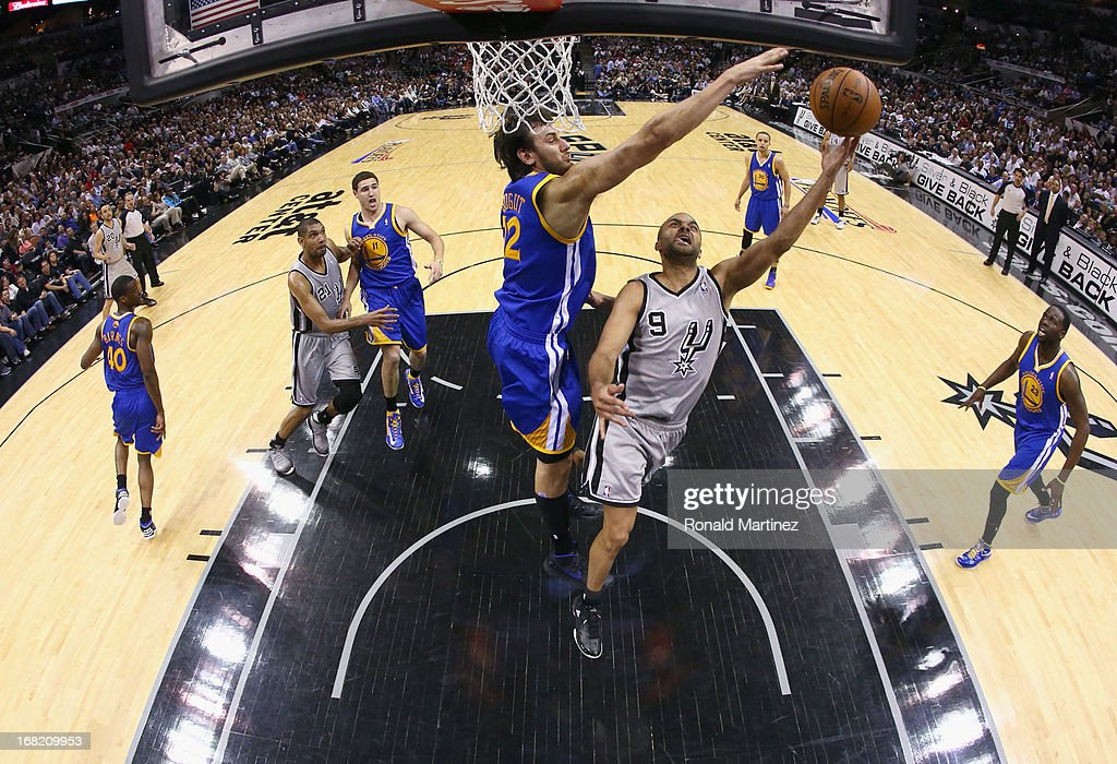 Tony Parker #9 of the San Antonio Spurs takes a shot against Andrew Bogut #12 of the Golden State Warriors during Game One of the Western Conference Semifinals of the 2013 NBA Playoffs at AT&T Center on May 6, 2013 in San Antonio, Texas.