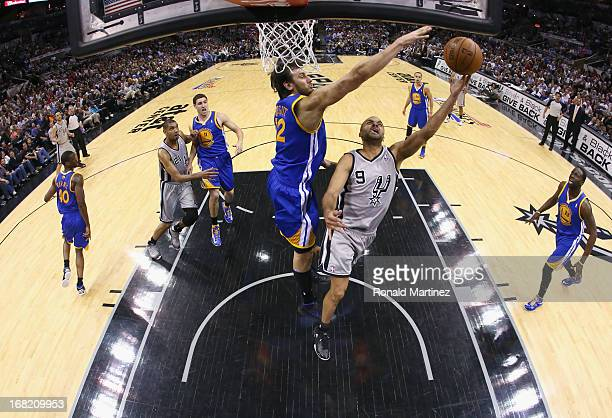 Tony Parker of the San Antonio Spurs takes a shot against Andrew Bogut of the Golden State Warriors during Game One of the Western Conference...