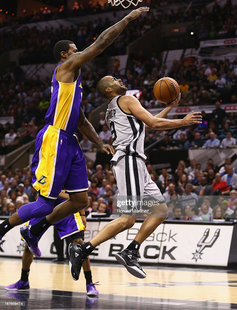 Tony Parker #9 of the San Antonio Spurs takes a shot against Earl Clark #6 of the Los Angeles Lakers during Game Two of the Western Conference Quarterfinals of the 2013 NBA Playoffs at AT&T Center on April 24, 2013 in San Antonio, Texas.
