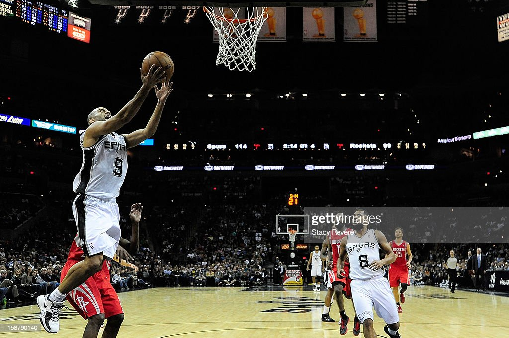 Tony Parker #9 of the San Antonio Spurs takes an open shot againt the houston Rockets during a game at AT&T Center on December 28, 2012 in San Antonio, Texas. San Antonio won the game 122-116.