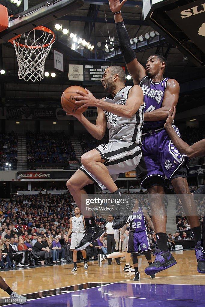 Tony Parker #9 of the San Antonio Spurs takes the ball to the basket against Jason Thompson #34 of the Sacramento Kings on February 19, 2013 at Sleep Train Arena in Sacramento, California.