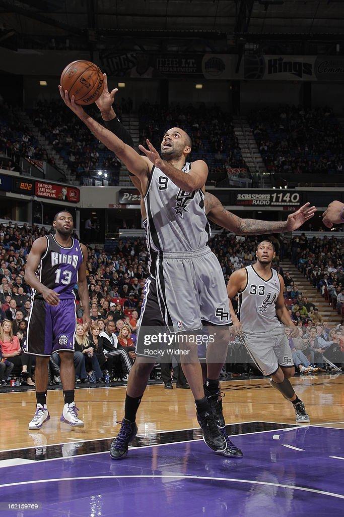 Tony Parker #9 of the San Antonio Spurs takes the ball to the basket against the Sacramento Kings on February 19, 2013 at Sleep Train Arena in Sacramento, California.
