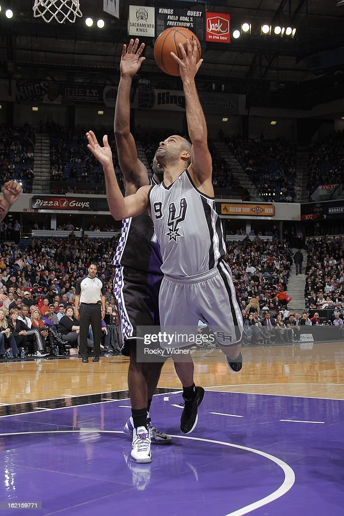 Tony Parker #9 of the San Antonio Spurs takes the ball to the basket against the Sacramento Kings on February 19, 2013 at Sleep Train Arena in Sacramento, California.