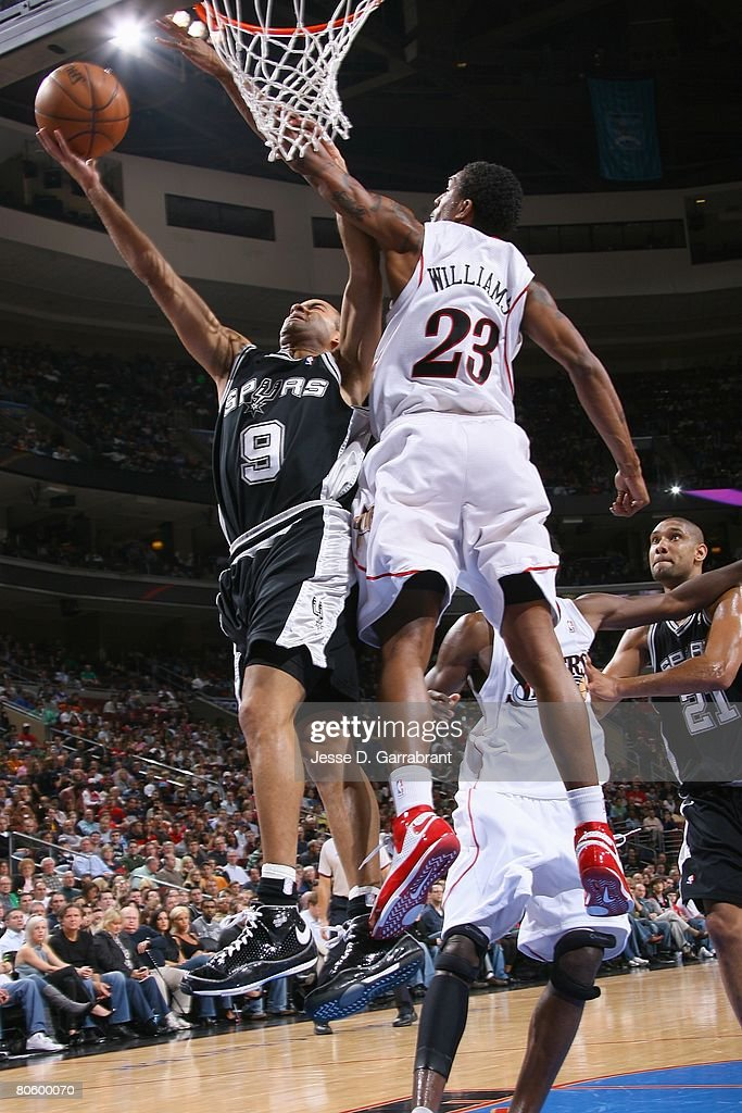 Tony Parker #9 of the San Antonio Spurs takes the ball to the basket against Louis Williams #23 of the Philadelphia 76ers during the game on March 15, 2008 at the Wachovia Center in Philadelphia, Pennsylvania. The Sixers won 103-96.