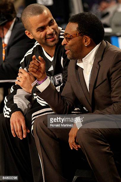 Tony Parker of the San Antonio Spurs talks to director Spike Lee during the Play Station Skills Challenge on AllStar Saturday Night part of 2009 NBA...
