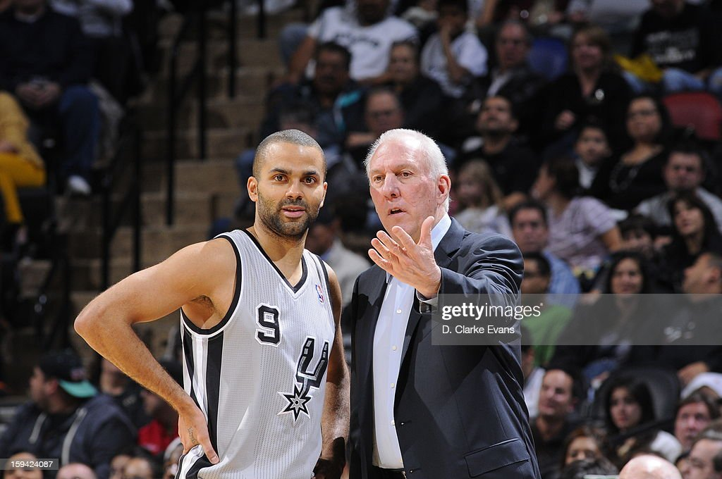 Tony Parker #9 of the San Antonio Spurs talks with Gregg Popovich during the game against the Minnesota Timberwolves on January 13, 2013 at the AT&T Center in San Antonio, Texas.
